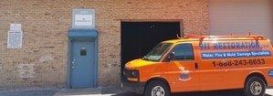 Water Damage Restoration Van Parked Outside Headquarters